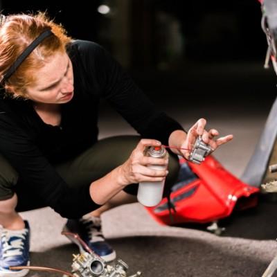 Female mechanic performing a maintenance on a motorbike in Osaka, Japan
